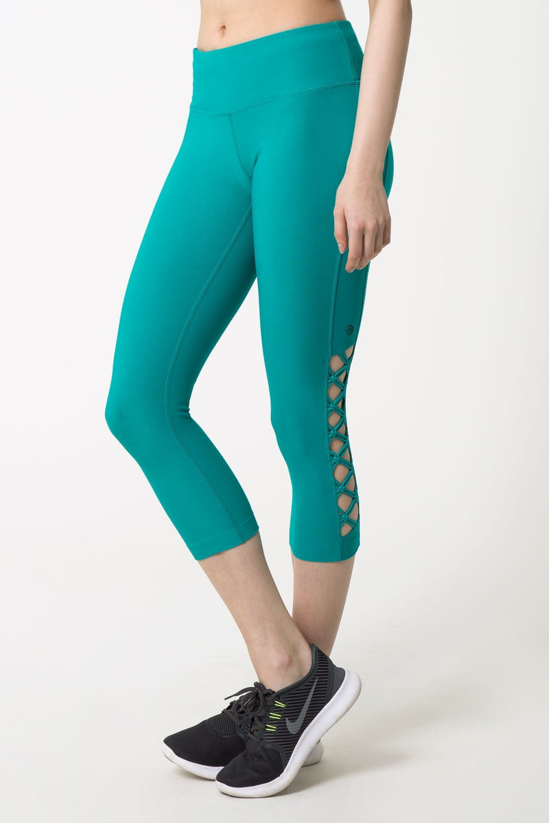 MPG Sport's clearance warehouse women's Enlace Macrame-Look Lattice Capri in Laguna Green