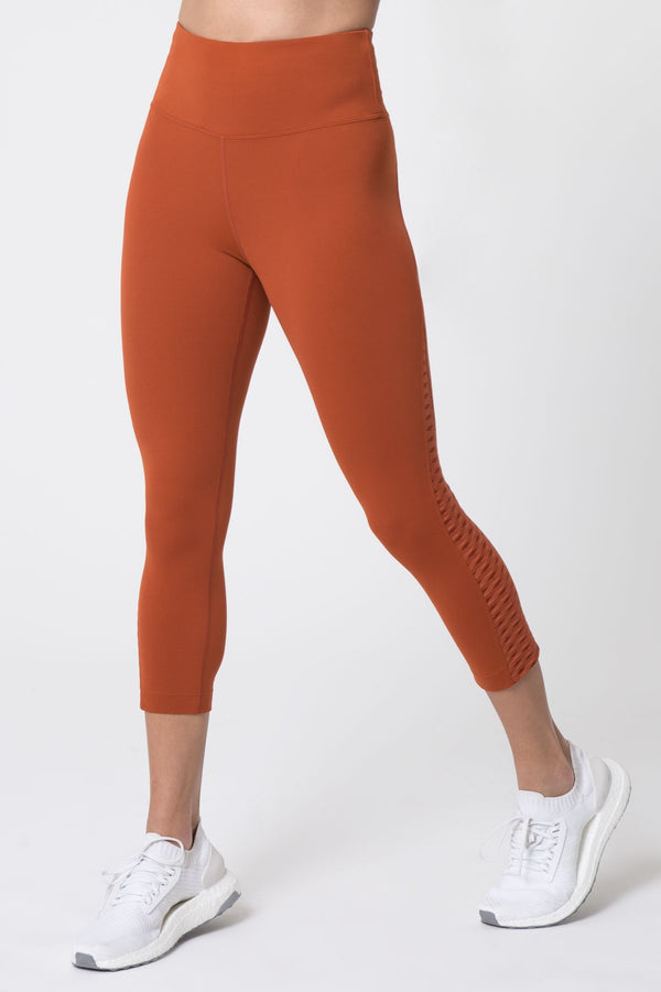 MPG Sport's clearance warehouse women's Dusk High Waist Diamond Mesh Capri in Terracotta Orange