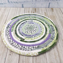 Load image into Gallery viewer, R2S Handmade Table Mat Fabric Placemat 11 Diameter Pastel Purples And Greens Ready To Ship