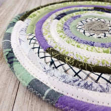 Load image into Gallery viewer, R2S Handmade Table Mat Fabric Placemat 12 Diameter Pastel Purples And Greens Ready To Ship