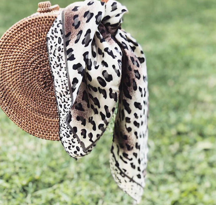 Best Ways To Dress Up Your Handbag With A Scarf