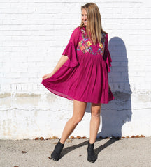 Bolt babe blog. pink embroidered flowy dress. black booties.