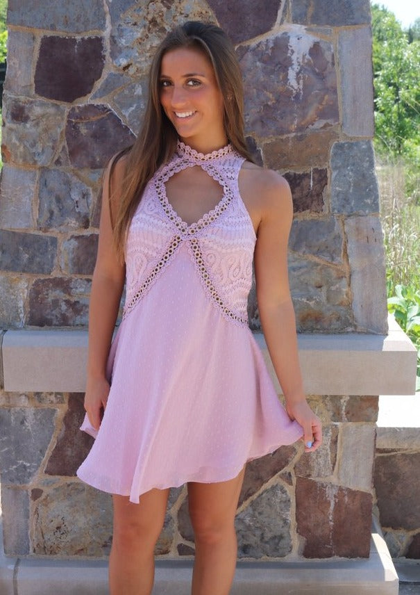 pink dress. high neckline with cutout. polka dots. lace. flowy.
