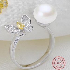 Featuring one ladies stunning pearl and sliver butterfly ring - AEIGARTZ.COM