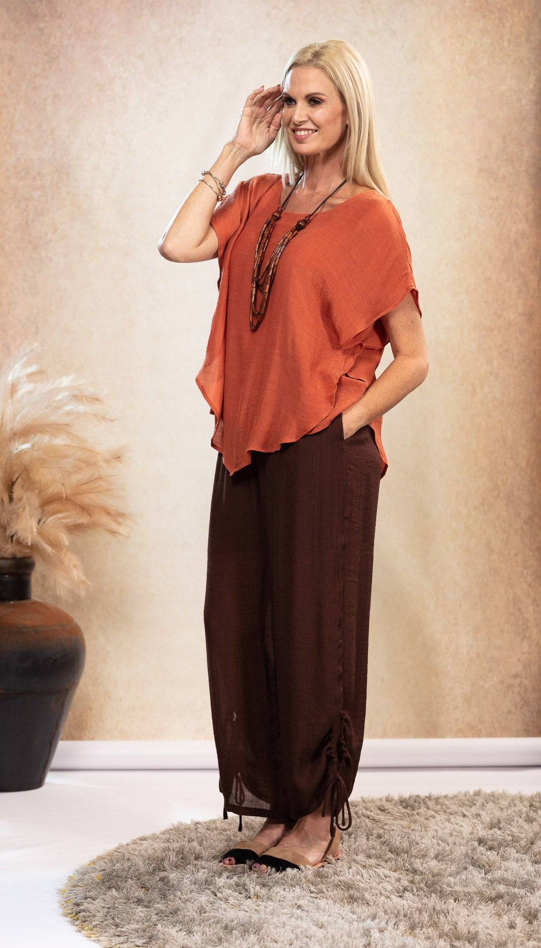 Long Bamboo Pants. Chocolate Brown Pants. Rust Earthy Orange Bamboo Top. Black and Tan Sandals. Suede Avarca Sandals. Natural Look.