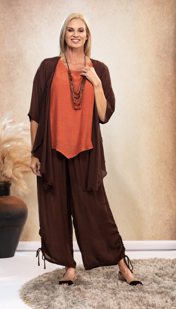 Long Bamboo Pants. Chocolate Brown Pants. Rust Earthy Orange Top. Chocolate Brown Jacket. Black and Tan Sandals. Suede Avarca Sandals. Natural Look.