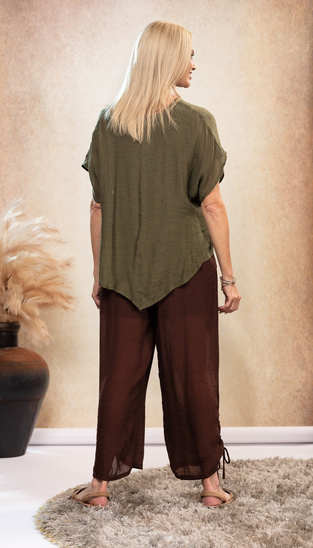 Bamboo Top earthy Olive Khaki Green colour. Bamboo Top with sleeve. Chocolate Brown long bamboo pants. Harem pants. Bamboo Pants with pockets. Natural coloured shoes. Nude colour Avarca sandals.