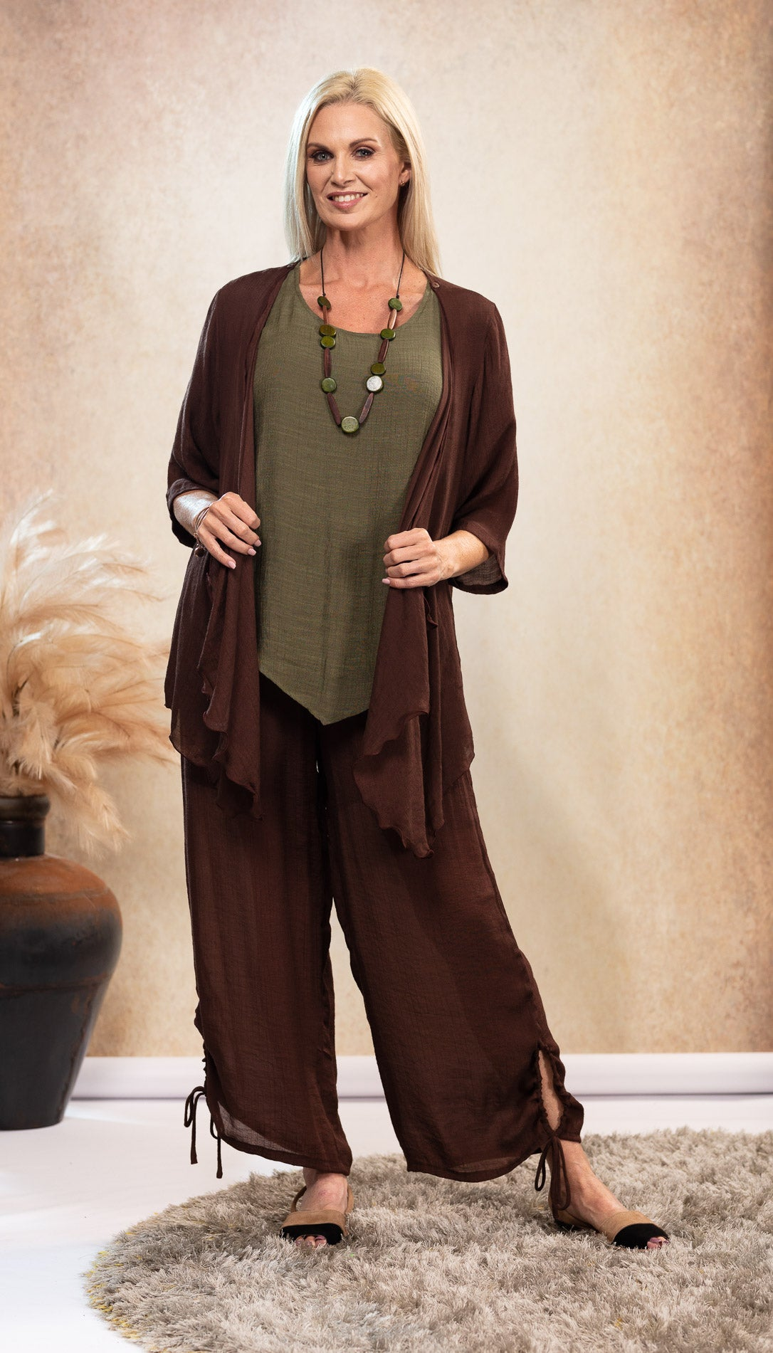 Long Bamboo Pants. Chocolate Brown Pants. Olive Khaki Green Bamboo Top. Chocolate Brown Jacket. Black and Tan Sandals. Suede Avarca Sandals. Natural Look.