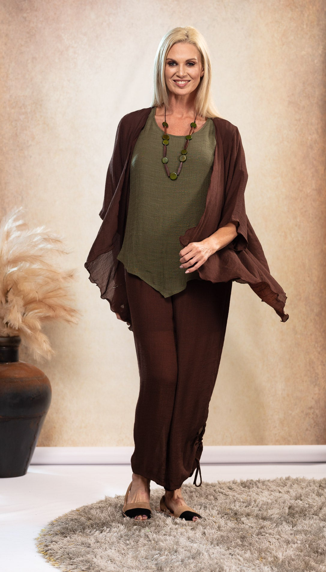 Bamboo Top earthy Olive Khaki Green colour. Bamboo Top with sleeve. Chocolate Brown long bamboo pants. Harem pants. Bamboo Pants with pockets. Chocolate Brown Jacket. Natural coloured shoes. Nude colour Avarca sandals.