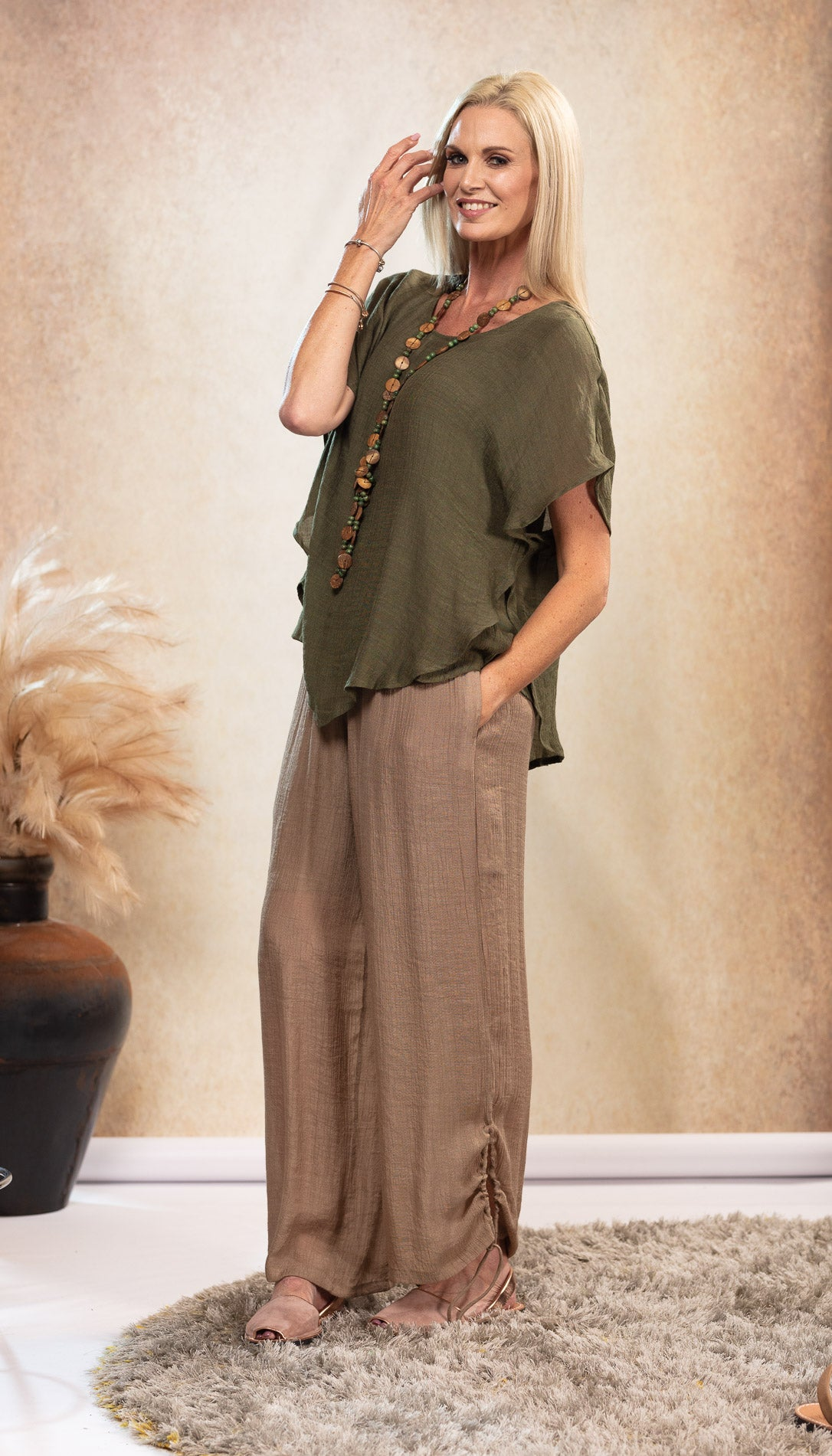 Bamboo Top earthy Olive Khaki Green colour. Bamboo Top with sleeve. Beige long bamboo pants. Harem pants. Bamboo Pants with pockets. Natural coloured shoes. Nude colour Avarca sandals.