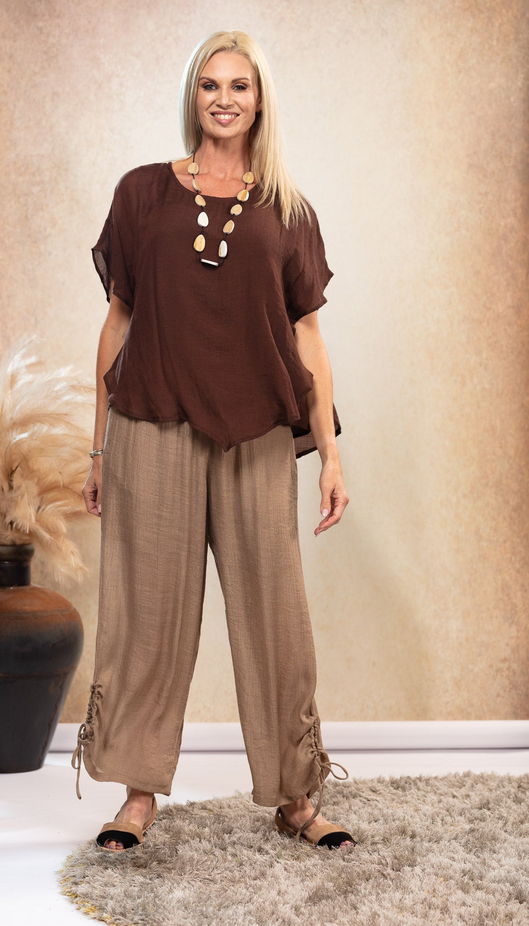 Bamboo Top in Chocolate Brown colour. Bamboo top with sleeve. Beige natural coloured pants. Long Bamboo Pants. Harem Pants. Black and taupe sandals. Black and tan Avarca sandals.