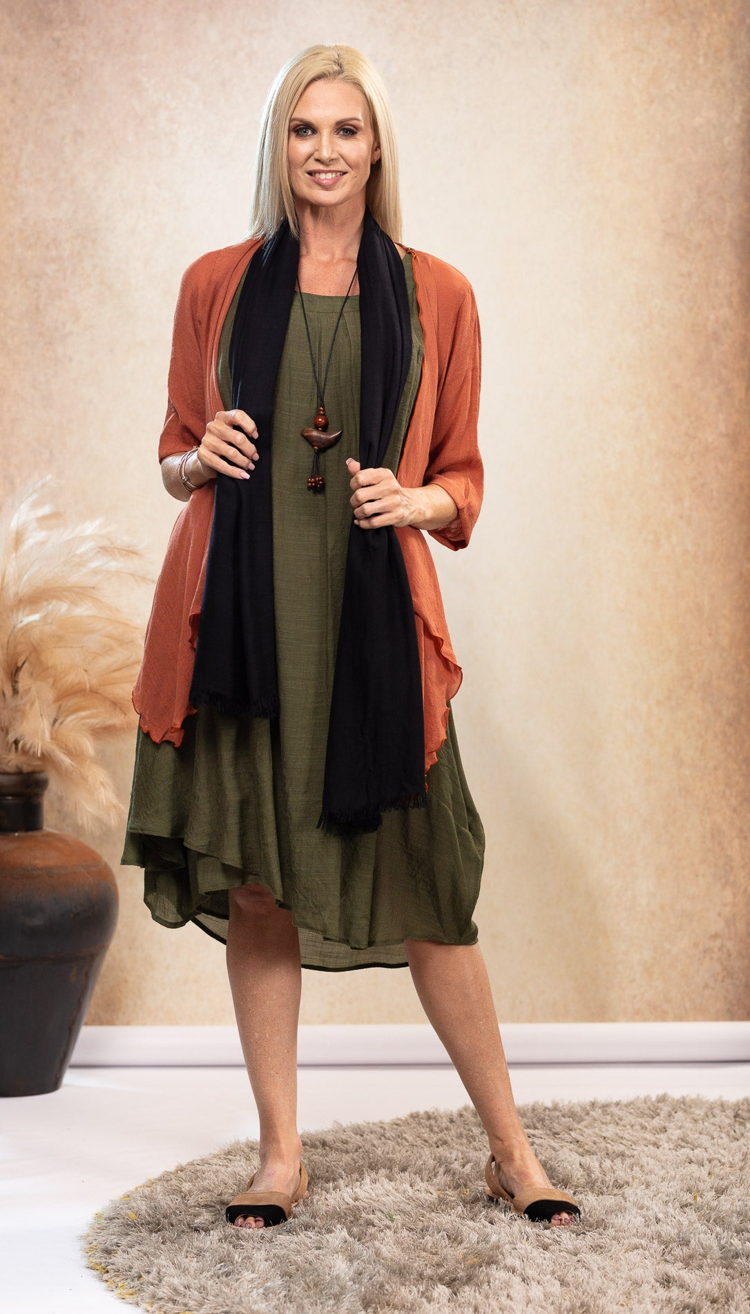 Bamboo Dress in Olive Khaki Green. Black and Taupe Avarca Sandals. Black Organic Bamboo Scarf. Infinity Top Jacket Rust Orange.