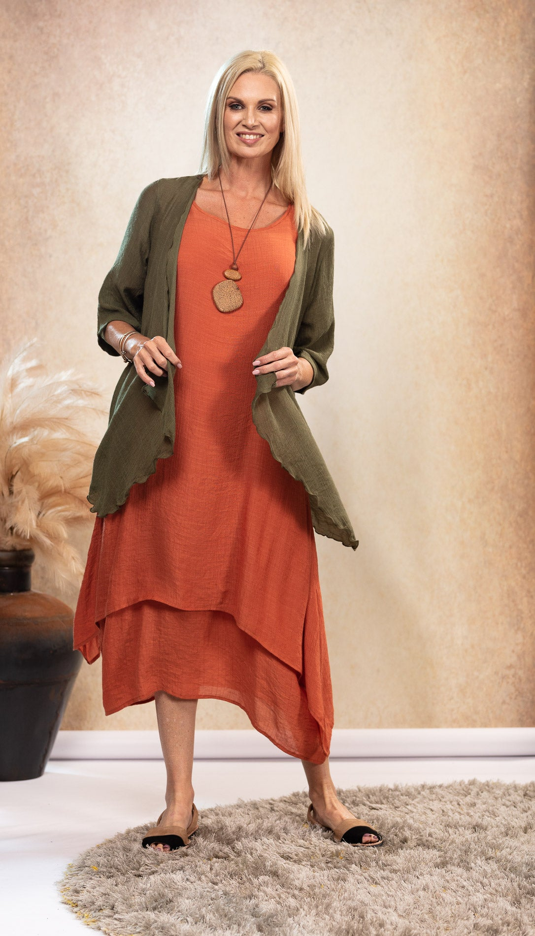 Bamboo Dress in earthy Rust with pockets. Olive green bamboo jacket. Avaraca sandals.