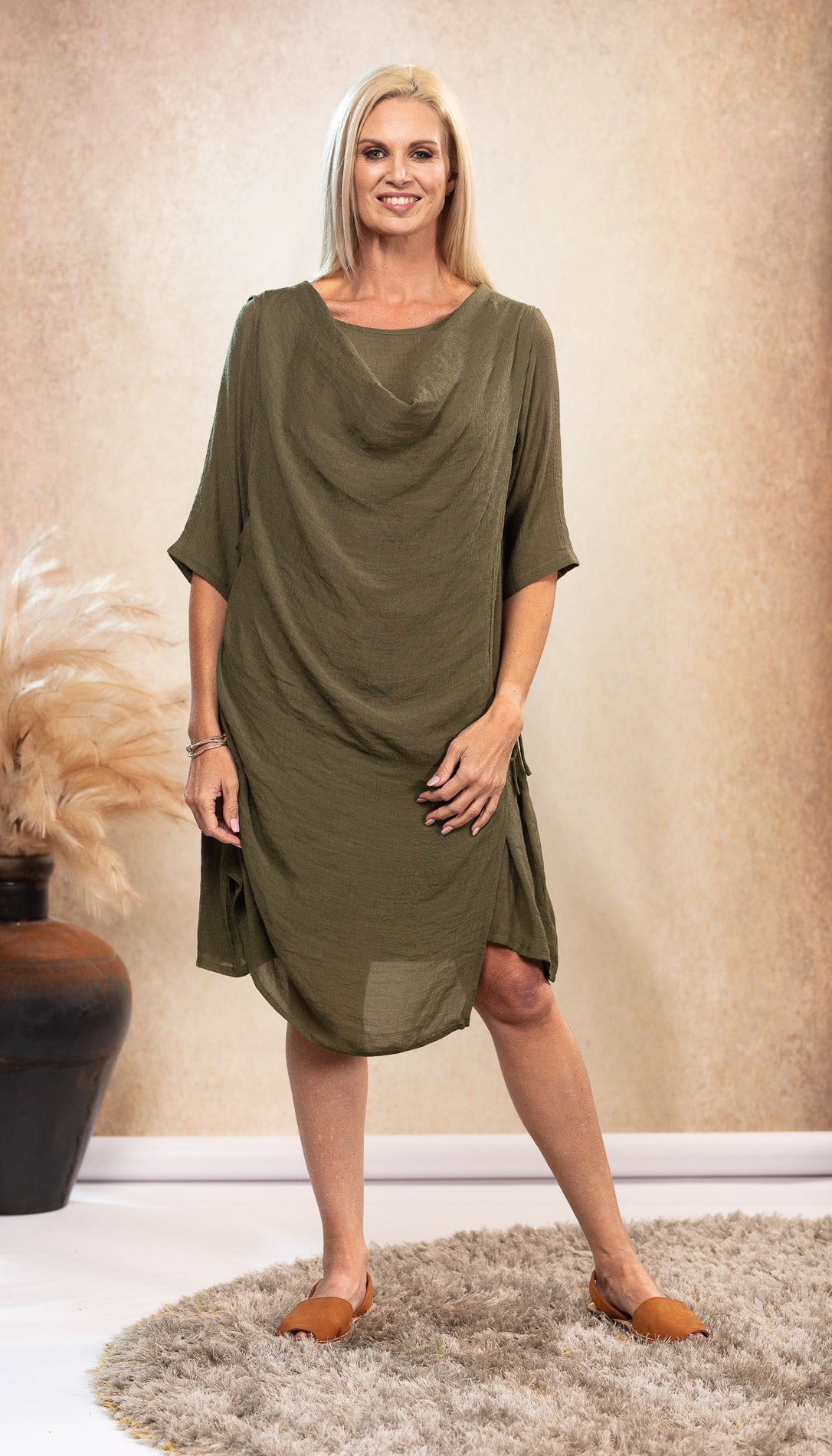 Bamboo Aphrodite Dress in earthy Olive Green. Bamboo Dress with sleeves.Tan Avarca sandals.