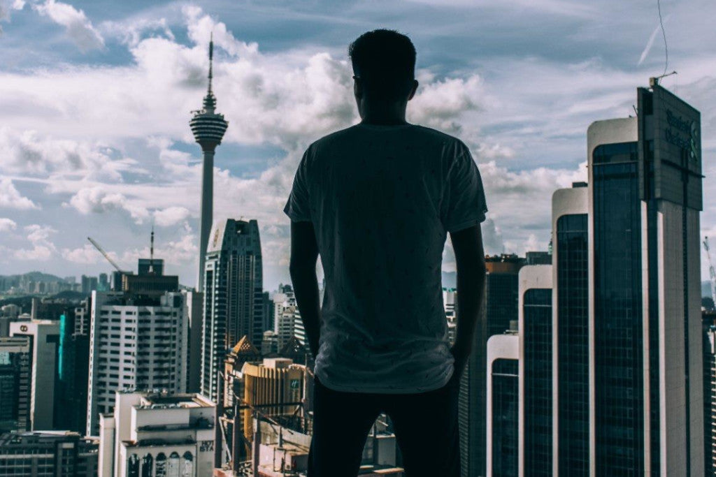 Man looking out over Auckland City