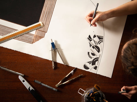 artist drawing with pens