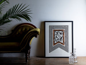 contemporary framed drawing next to chaise lounge