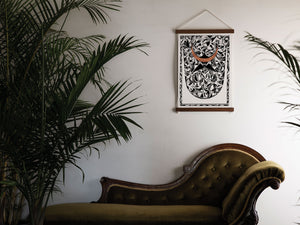 print above chaise lounge with palm trees
