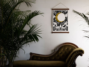 print above chaise lounge with palms