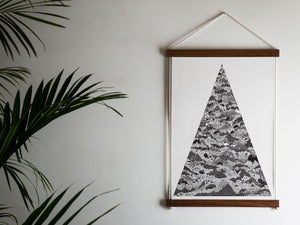 triangle print next to palm