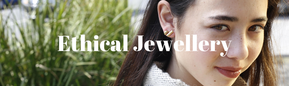 ethical jewellery with a female wearing two types of fair trade stud earrings