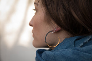 woman wearing Cynthia Jones two tone hoop earring