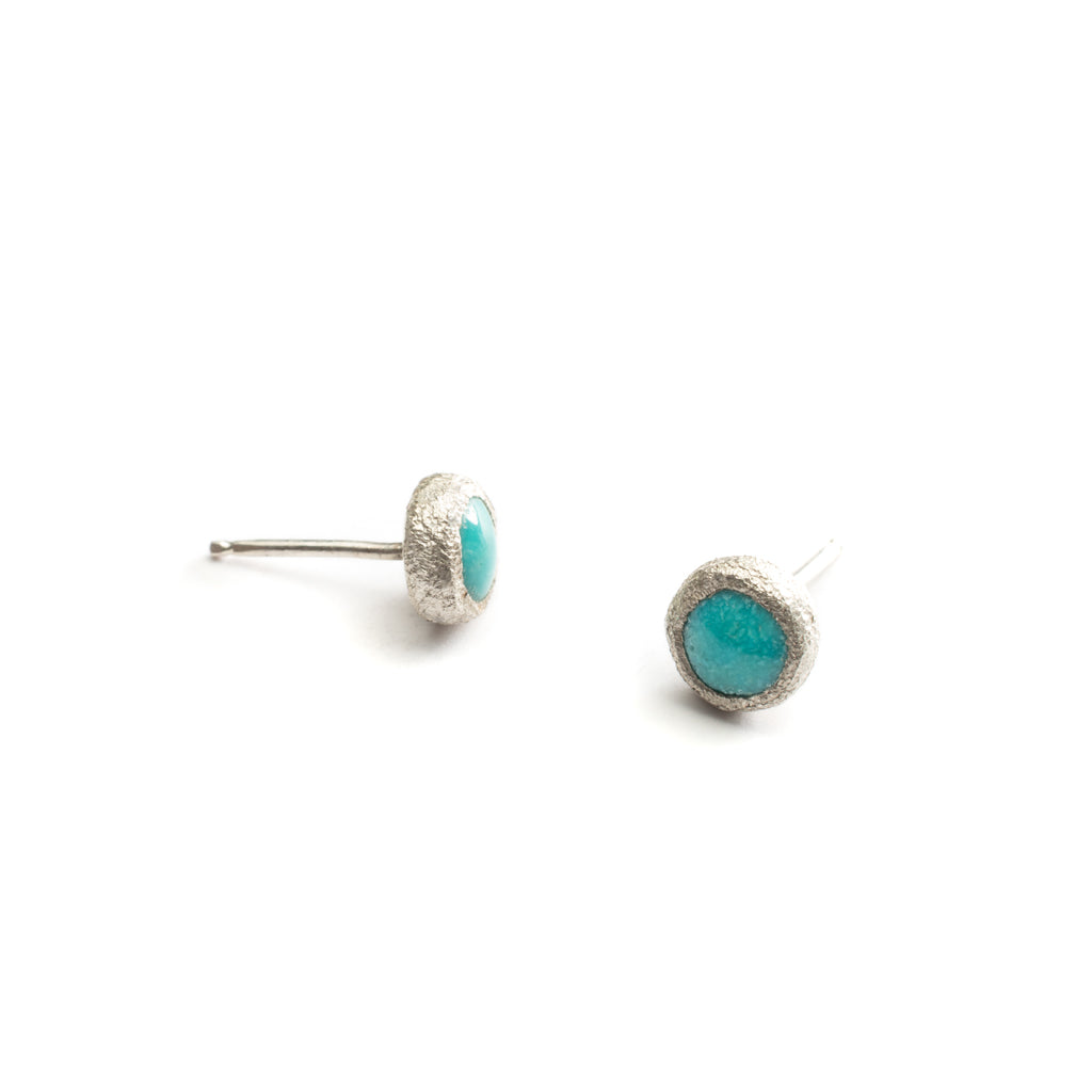 Understated studs in turquoise or opal both held in sterling silver with sterling posts