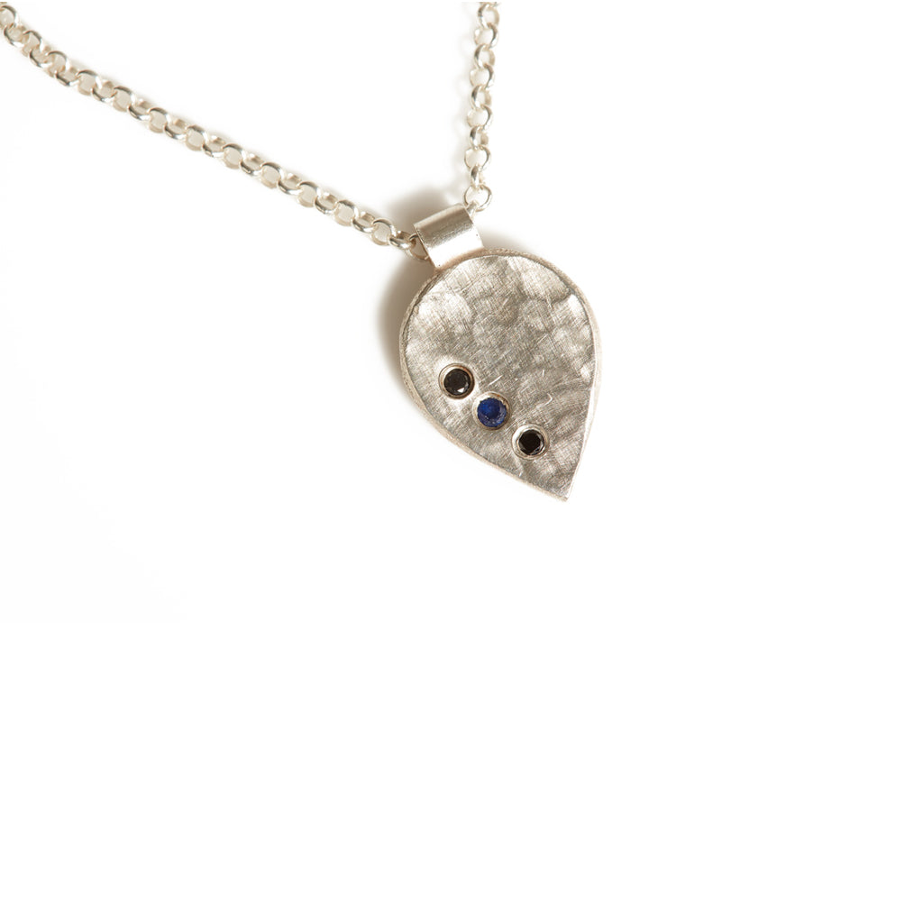"Hammered Sterling Silver Necklace with two black diamonds and a blue sapphire in the center with 18"" long silver chain"