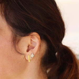close up ear gold bar stud earring and cluster stud