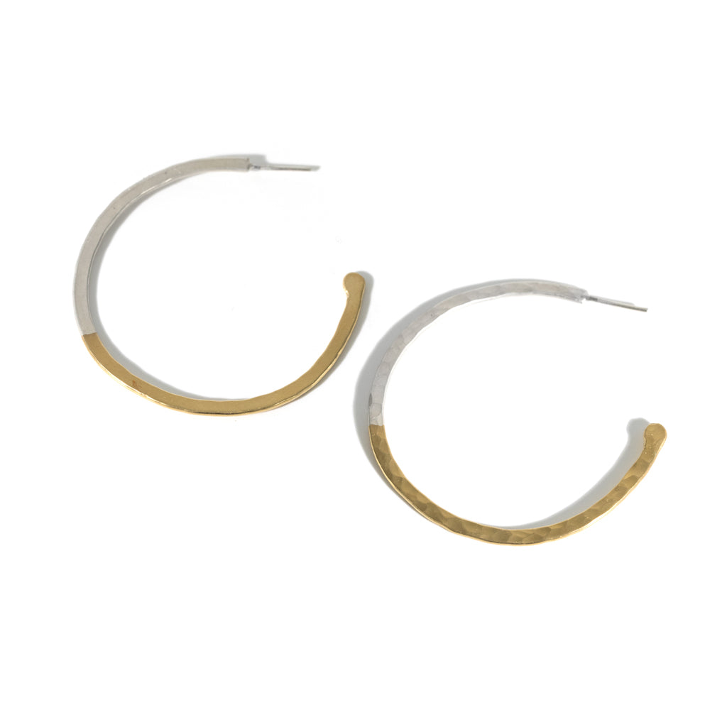 These handmade hoops seamlessly blend gold and sterling silver in a stunning update on a classic silhouette