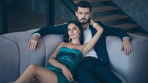 Confident man on couch with woman