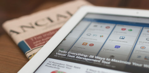 close up of ipad and newspaper