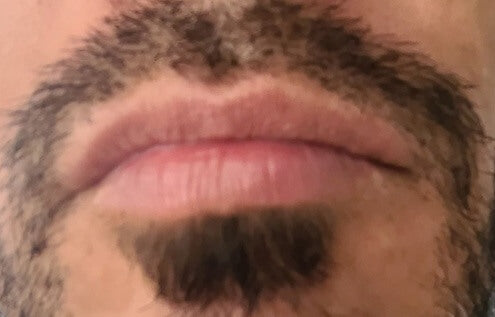Green Lumber team member's moustache