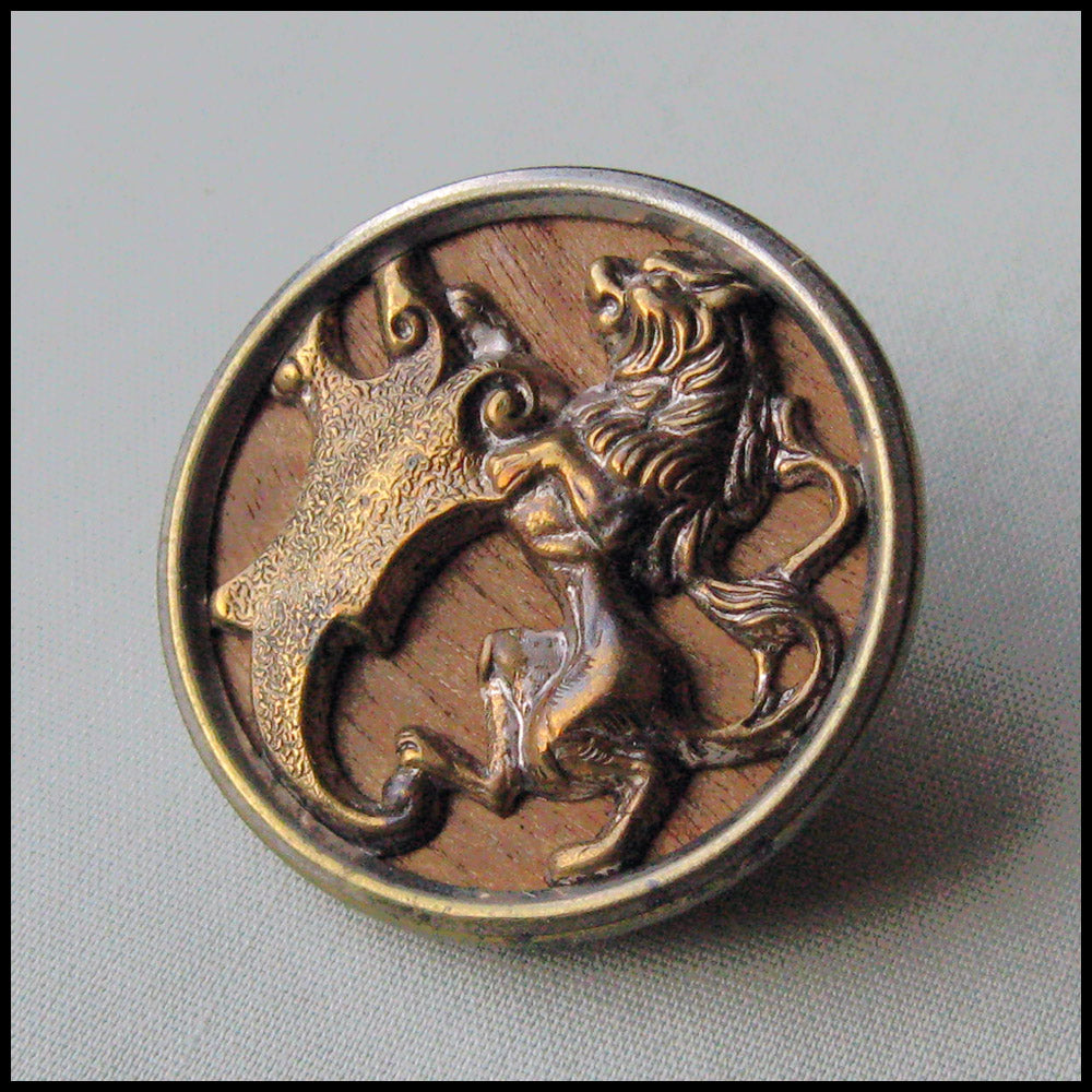 btvn772-Antique stamped brass over wood picture button. Lion, 1 1/8 inch diameter