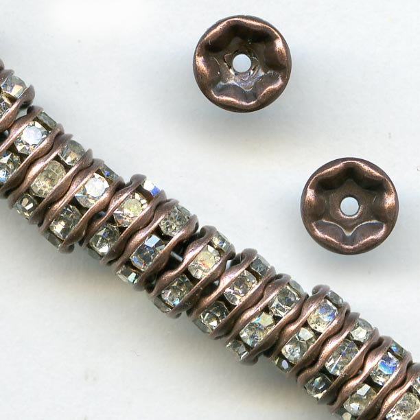 Clear rhinestone rondelle with antiqued copper. 4.5mm. Pkg of 4. b18-0270-1