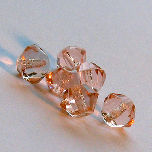 Vintage Saturn shape faceted peachy pink glass bead. 7x5mm pkg of 20. b11-pp-1004(e)