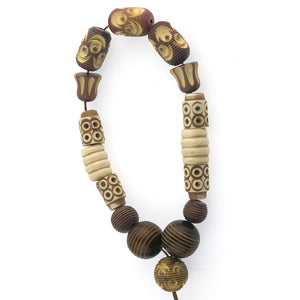 Strand of 16 vintage carved Galalith and celluloid beads. c. 1930s.  b6-231