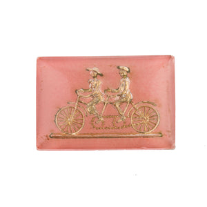 Vintage Bicycle built for two glass intaglio gold foil on pink. 25x17mm. Pkg of 1. b5-513