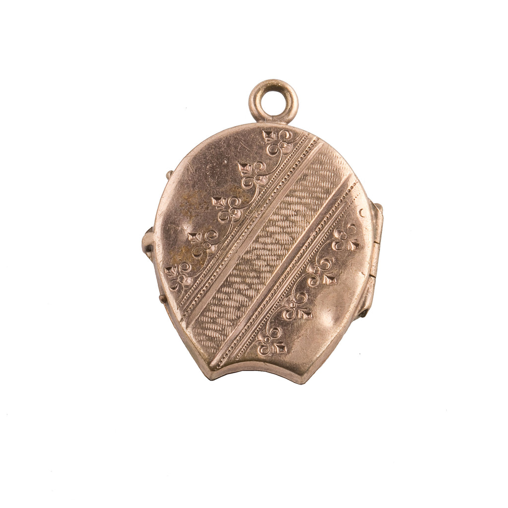 Antique Victorian 12k sold rose gold locket in a horseshoe shape with pearl 3 leaf clover.. pdvc471