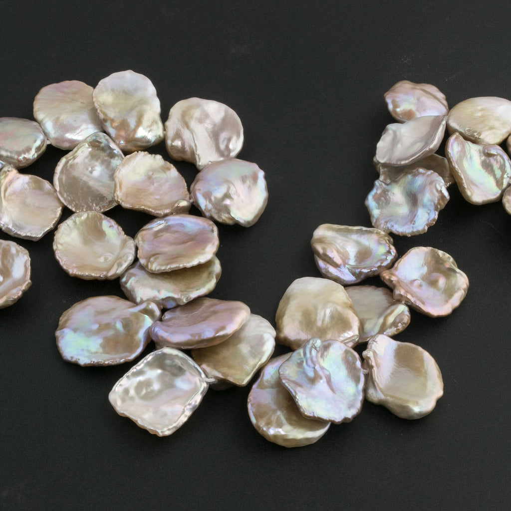 Freshwater keishi thin concave petal pearls. All natural. Extraordinary luster. 12-18mm. 1980s.  10 pcs. b15-prl126
