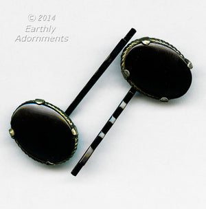 Pair of vintage sleek oval black glass earrings set in brass repurposed to a hair pin. ac-h-0100