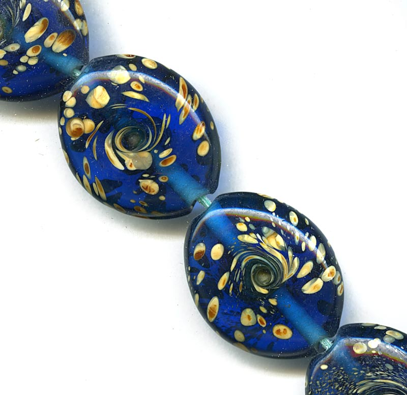 Transparent blue glass ovals with lampworked creamy swirls, 25x20mm, Pkg of 1. b11-bl-1126