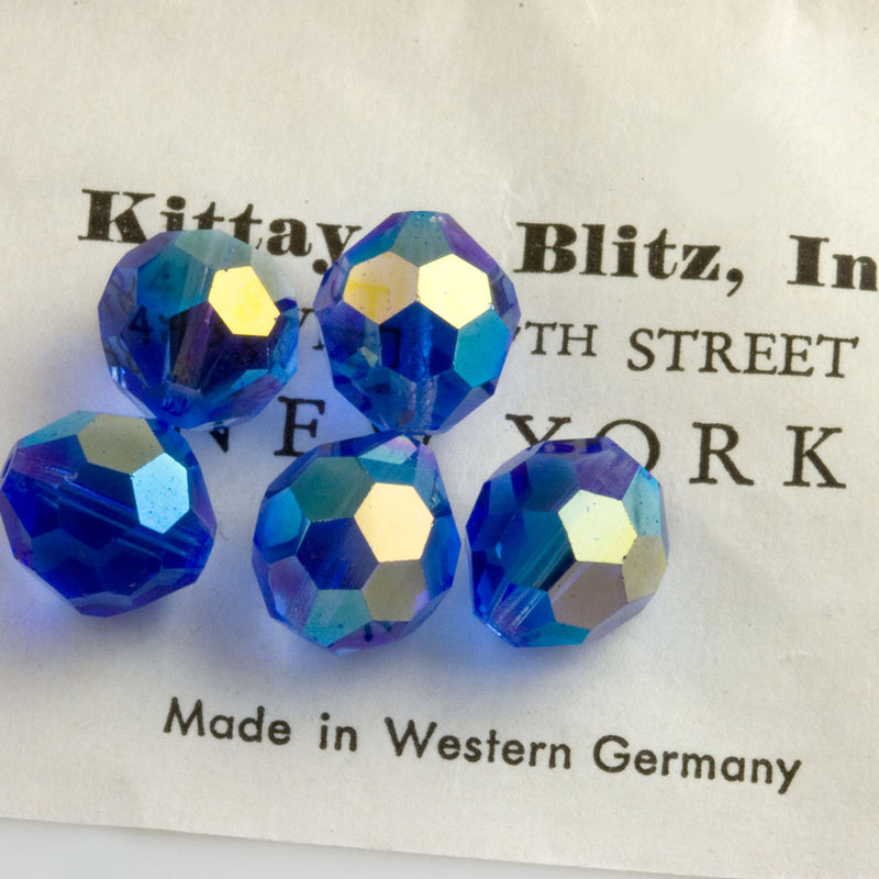 Vintage machine cut sapphire faceted glass rounds with partial AB