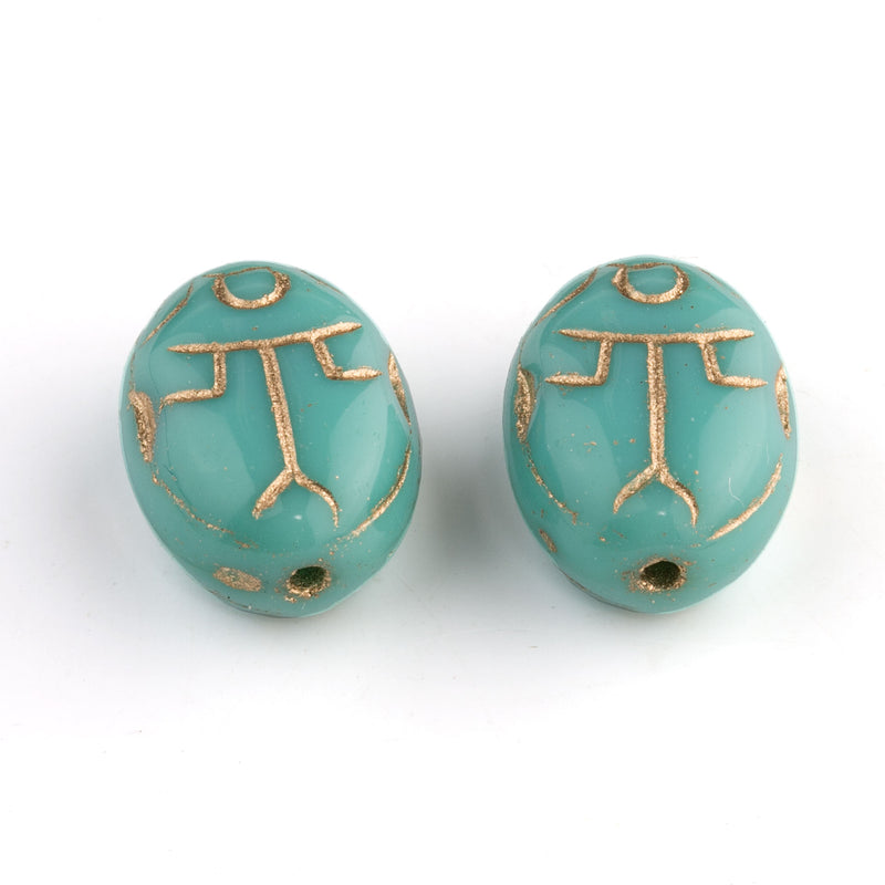 Czech pressed turquoise glass scarab bead with gold decor. 14x10x7mm. Pkg 2. b11-bl-2136
