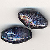 b11-bl-0975-Translucent blue pinched oval nuggets with a sparkly matrix overlay. 12x20mm. Pkg of 4