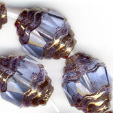 b11-BL-0987-Faceted light sapphire oval with bronzed edges. 8x10mm. Pkg of 4
