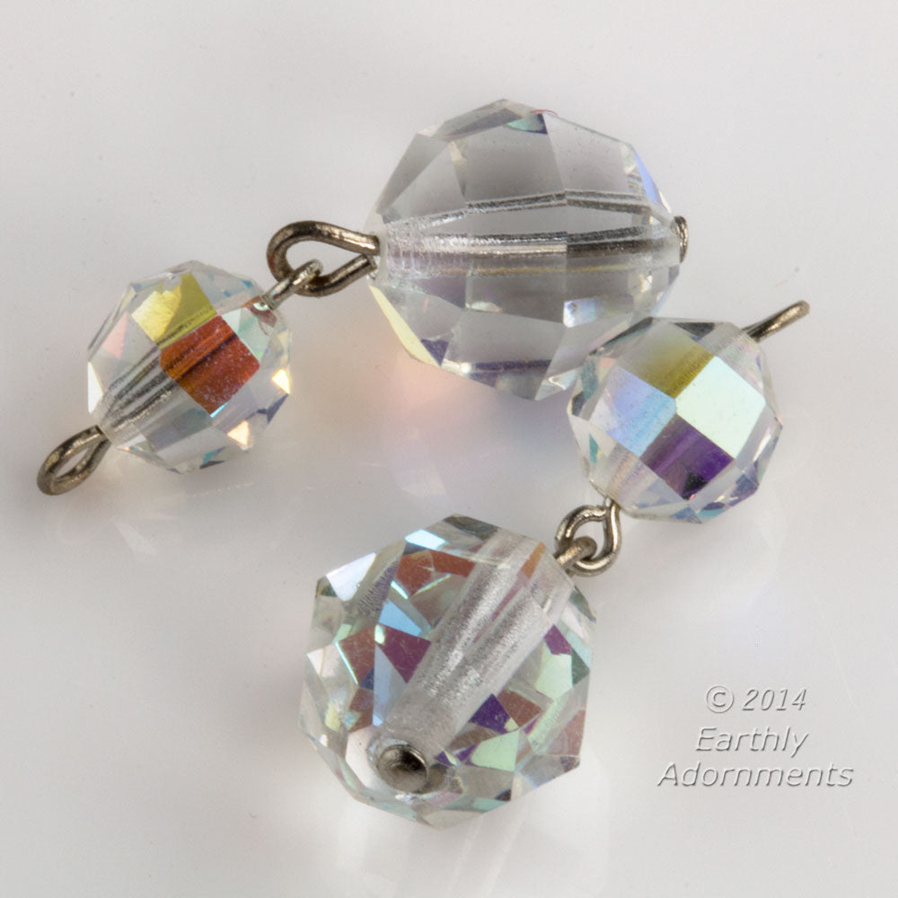 Two bead faceted crystal aurora borealis dangle on silver wire.