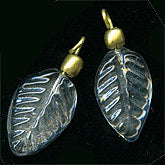 b11-cr-0507-Vintage clear pressed glass leaf pendant with brass bead and wire loop. India. 15x10mm. Pkg of 4