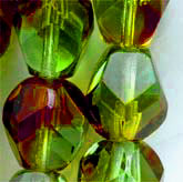 B11-GR-0958 Olivine and Ruby faceted glass bead. 8x10mm. Pkg of 5