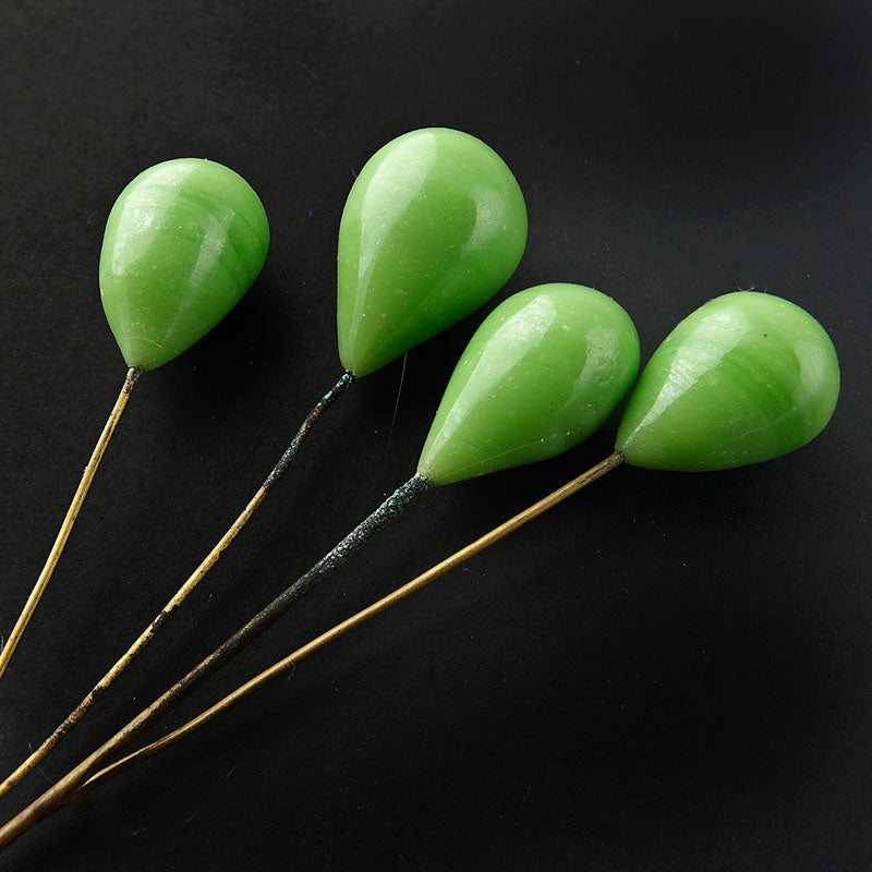 Opaque apple green glass teardrops on brass wire. Pkg of 8. b11-gr-1022